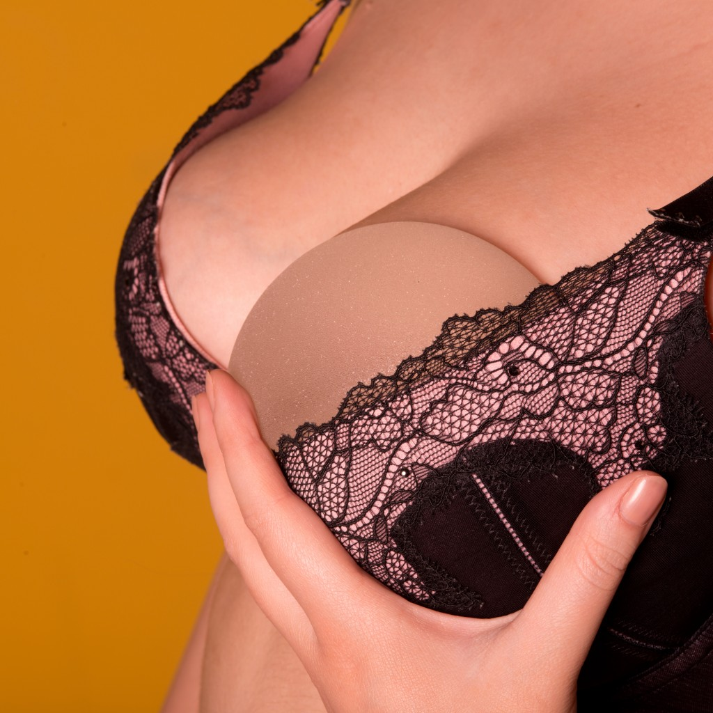 Silicone implants on bra with natural brest